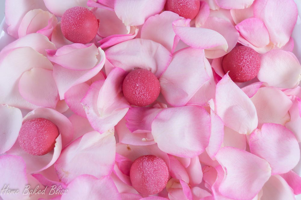 Rose water truffles on a bed of rose petals.