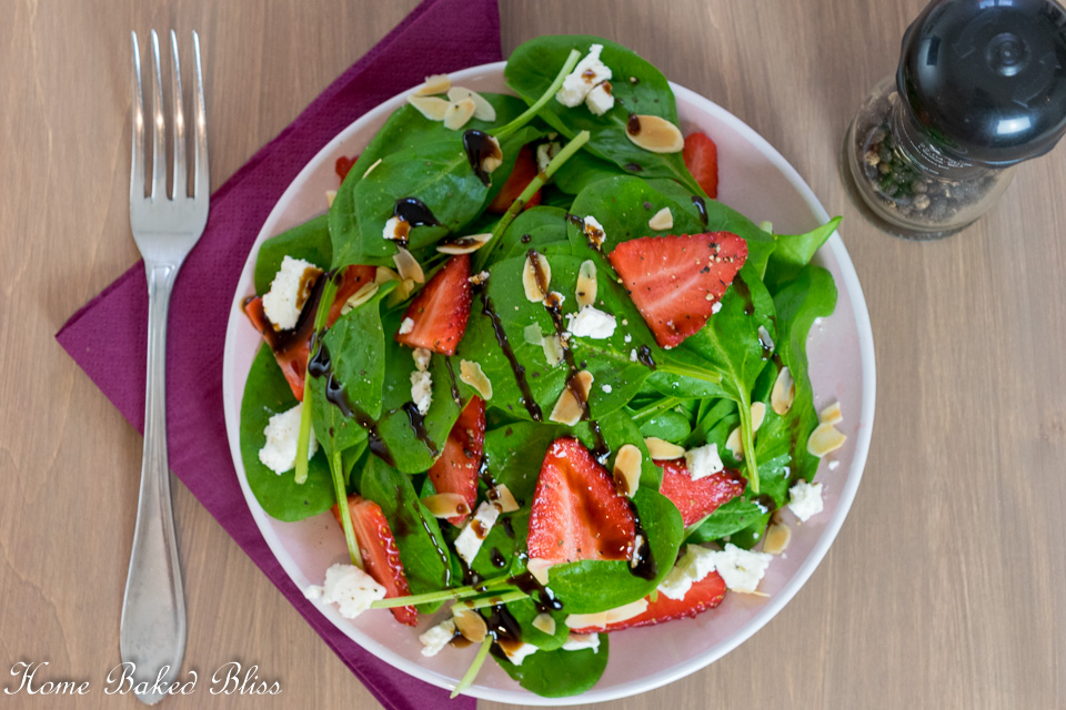Strawberry Feta Spinach Salad on a pink plate.