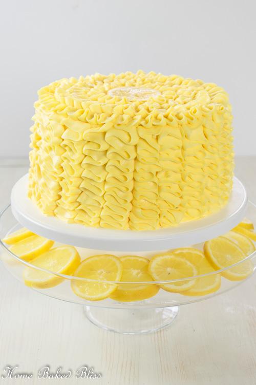 Lemon Ruffle Cake on display on a white cake stand