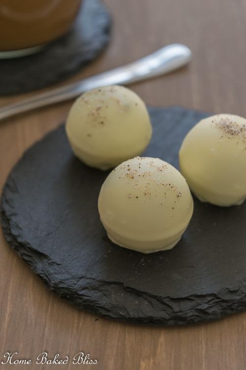 Cappuccino Truffles on a black stone plate.