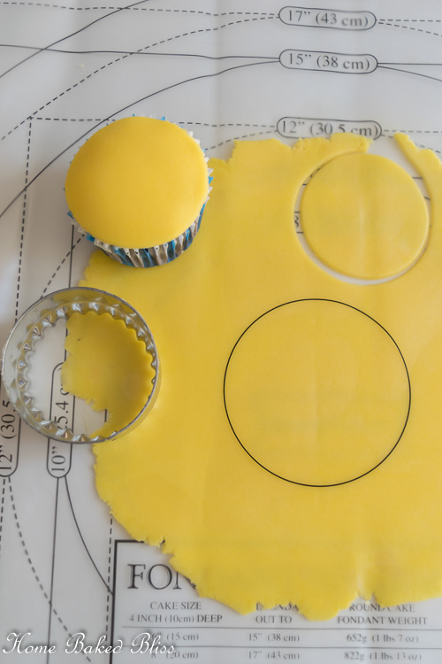 Rolling out yellow fondant for Minion cupcakes