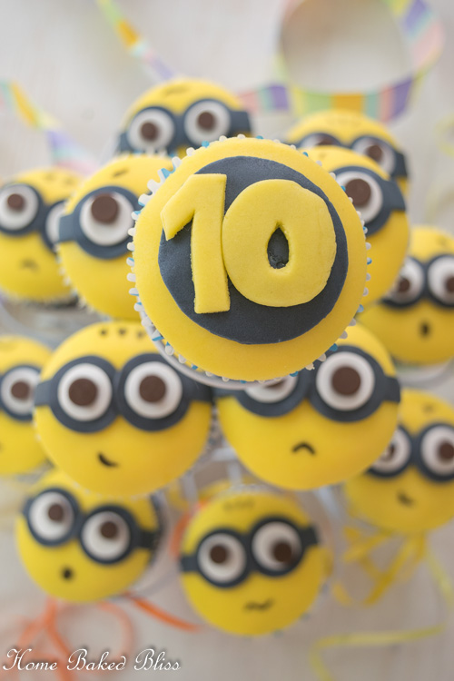 Minion Cupcakes on a white cupcake stand