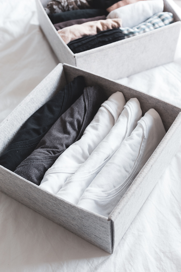 Shirts stored vertically in a box