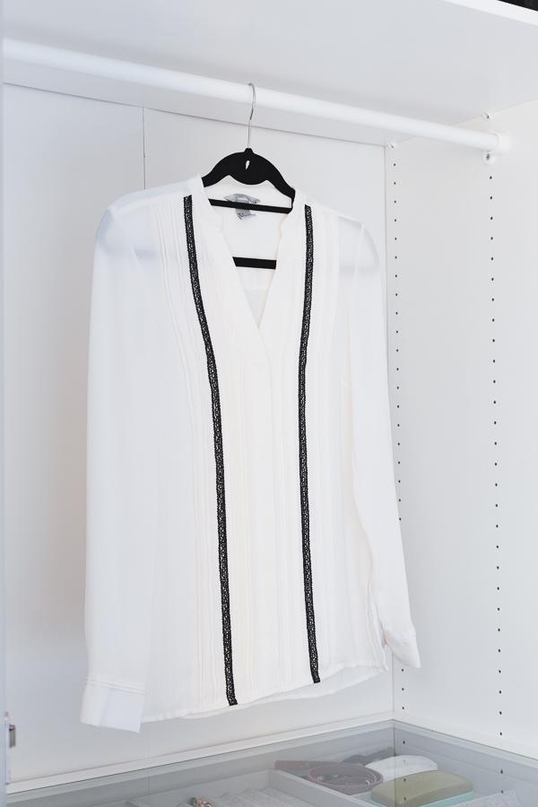 A blouse on an empty rack