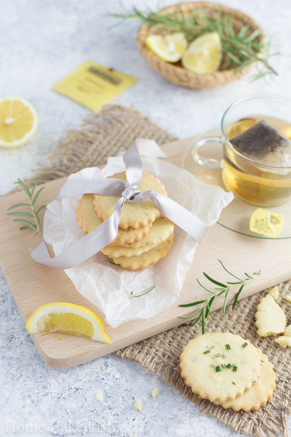 Rosemary lemon cookies packed in parchment paper and wrapped with a pink ribbon