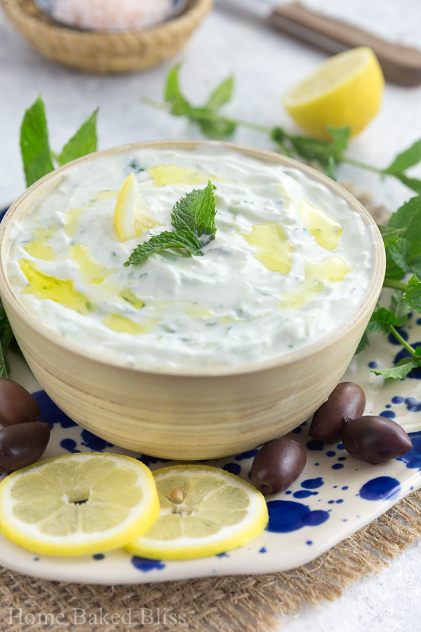 A bowl of Greek tzatziki drizzled with olive oil.