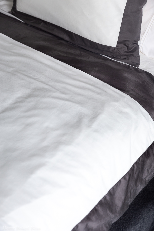 Wrinkle free white and grey sheets.