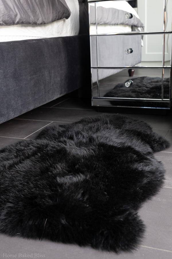 A black sheepskin rug.