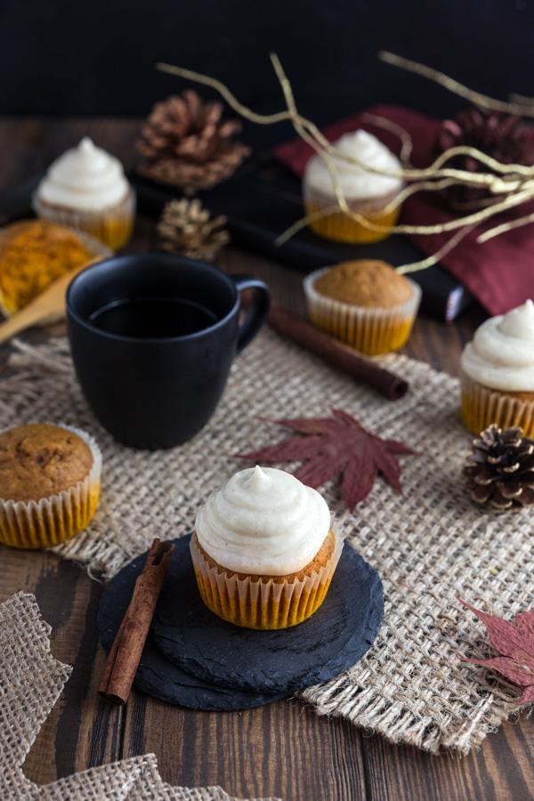 Pumpkin cupcakes on a piece of burlap.