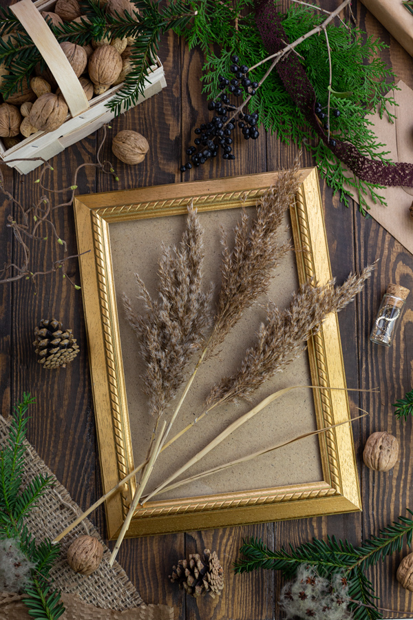 A gold frame decorated with ornamental grass