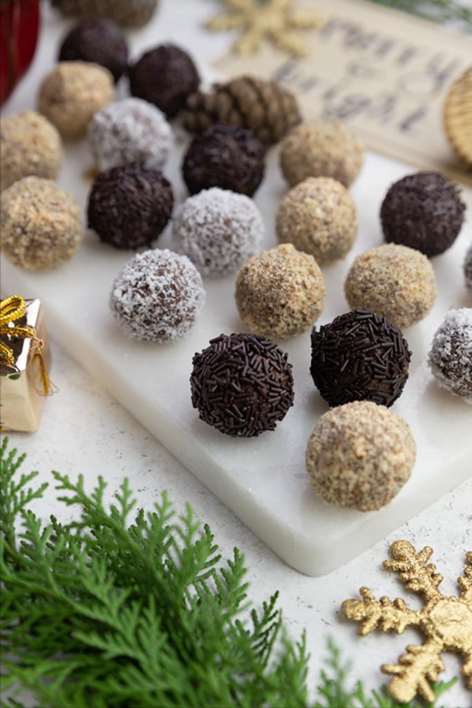 Closeup of vegan rum truffles coated in chocolate sprinkles