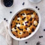 Blueberry Croissant Breakfast Casserole in an oval casserole dish