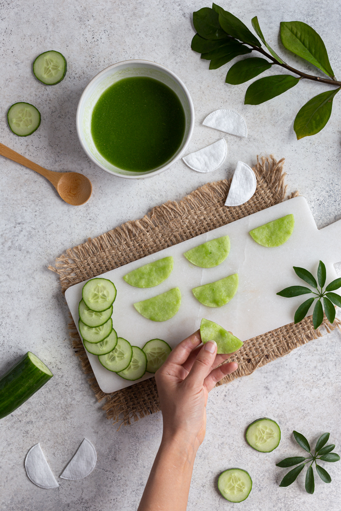 Dipping cucumber eye pads into mixture