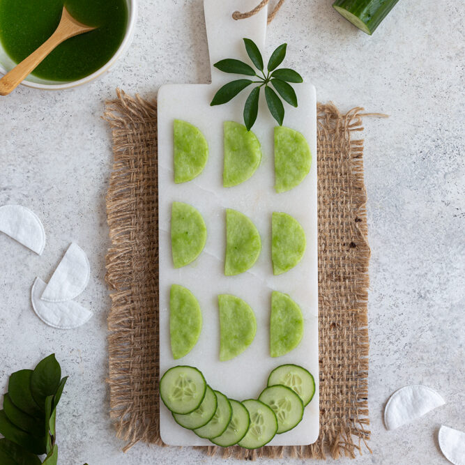 DIY Cooling Cucumber Eye Pads on a white tray