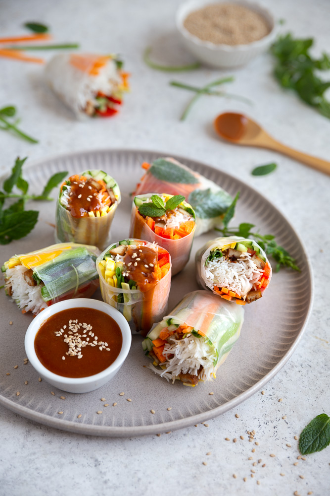 Vegan rice paper rolls drizzled with peanut sauce