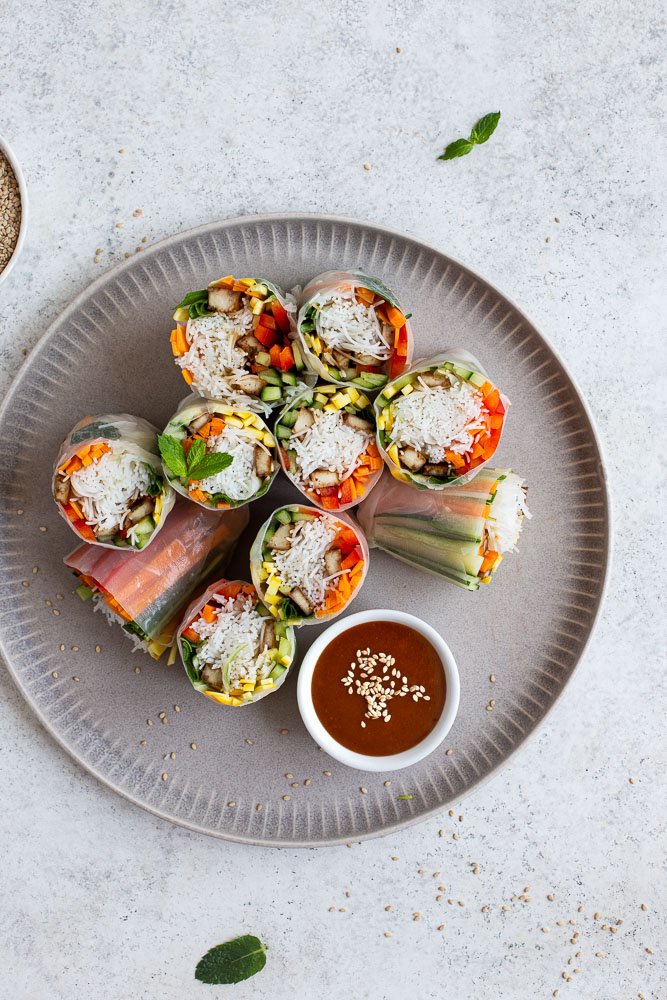 Vegan rice paper rolls on a large plate